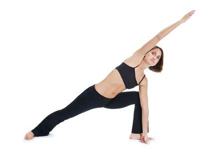 Young female gymnast practicing yoga.