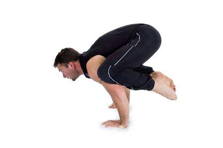 Young male gymnast practicing yoga.