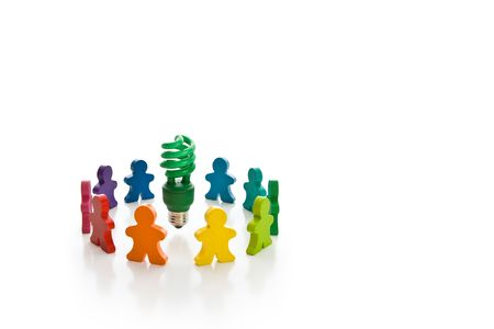Circle of brightly colored wooden people surrounding a bright green compact fluorescent light bulb. Isolated on white with copy-space. Stock Photo - 3546885