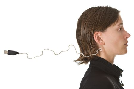 Expressionless young woman with USB cable in her neck - ready to be plugged in. Isolated on white background.