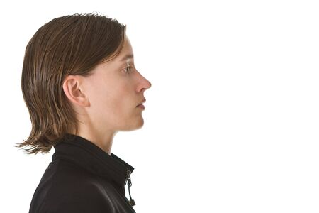 Profile portrait of a young woman wearing black. Isolated on white.