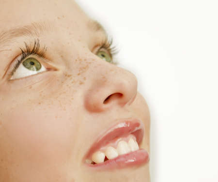 Closeup of girl with freckles on her face Stock Photo