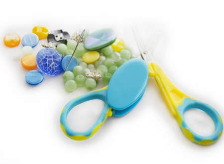 Closeup of buttons, needle and scissors Stock Photo