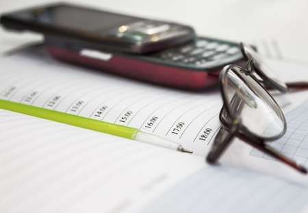 Pen, mobile phone and glasses in composition Stock Photo - 12183611