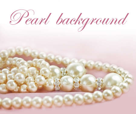 Background with Pearls  necklace on  fabric photo