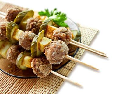 Roast meatballs on skewers  photo