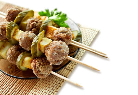 Roast meatballs on skewers  Stock Photo