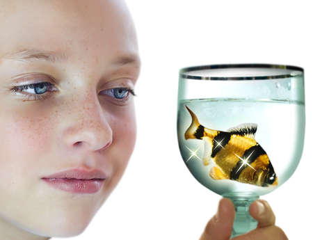 Closeup face of girl looking at golden fish Stock Photo