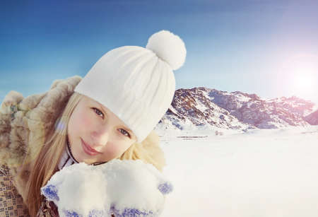 Beautiful girl on the winter background photo