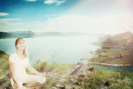 Beautiful girl  meditating in lotus pose Stock Photo