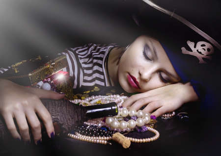 costume jewelry: Woman pirate sleeping  with a bottle