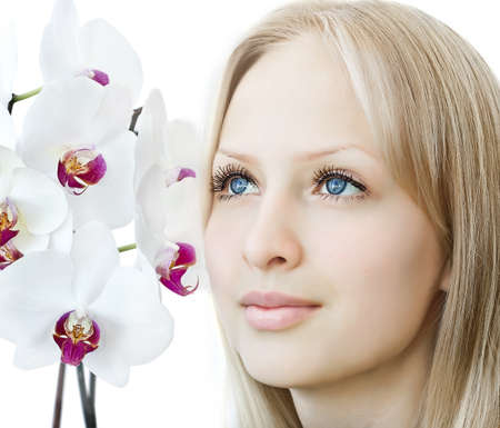 Closeup woman face with white orchid