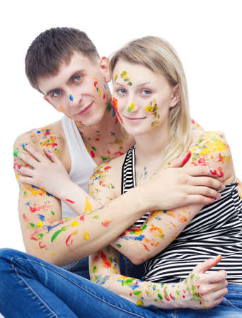 Portrait of woman and man covered with paints