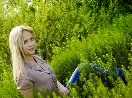 Beautiful blonde woman  in green grass