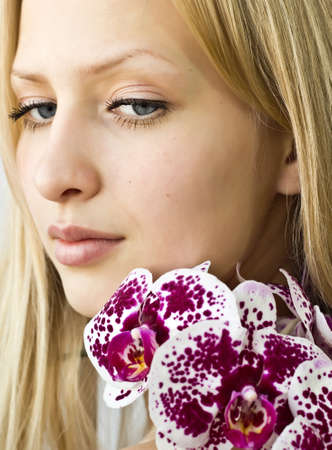 Closeup beautiful girl with orchids