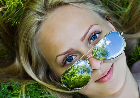 Summer reflection  in sunglasses of woman Stock Photo