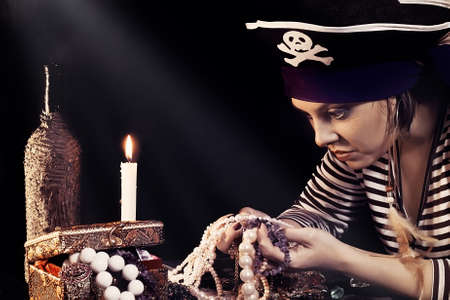 Woman the pirate  looking at jewelry Stock Photo