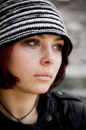 Closeup woman face in grunge style with tears Stock Photo