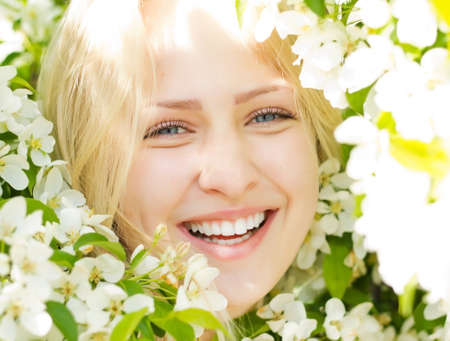 Closeup laughing woman among blossom tree Stock Photo - 19808219