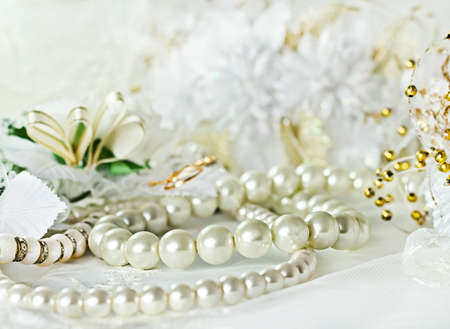 Wedding background with Pearl necklace photo