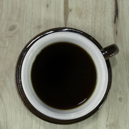 dring: coffee cup top view on the wood, nature and flash lighting Stock Photo