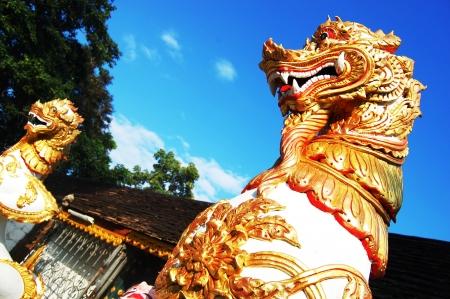lion figurines: Singha at Wat Phra That Doi Kham   chiangmai   thailand Stock Photo