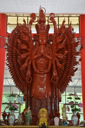 Thousand hands wooden Guanyin in Chinese temple,Thailand photo