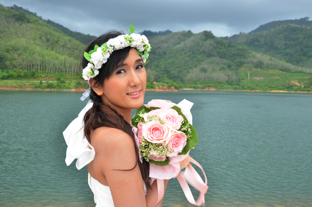 Pre Wedding  Bride Thai Women  at Bangneow Dam reservoir Phuket Thailand photo