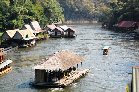 Houseboat go to float raft downstream at the River Kwai Kanchanaburi Thailand photo