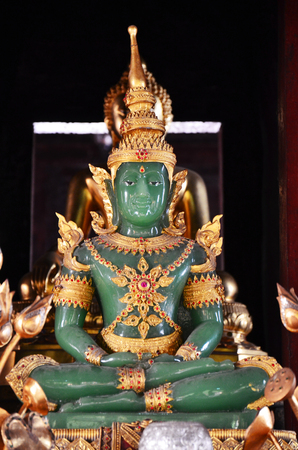 Emerald Buddha at Wat Phra Singh Woramahaviharn located in Chiang Mai Thailand photo