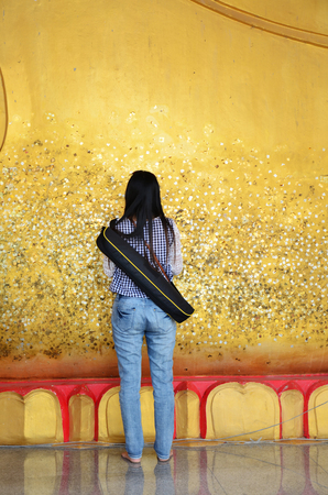 Photography glid cover Reclining Buddha with gold leaf at Wat Ras Prakorngthum Nonthaburi Thailand