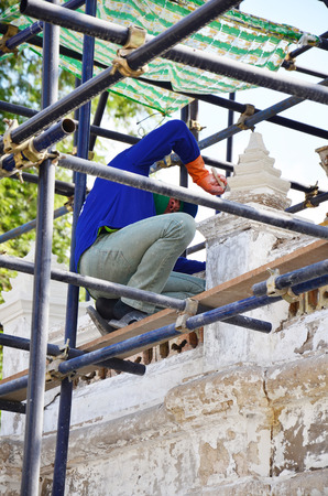 carver: Carver restore chedi at Wat Thepthidaramvaraviharn Bangkok Thailand