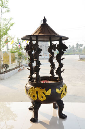 wood burner: joss stick pot or thurible at  Wat Ras Prakorngthum Nonthaburi Thailand Stock Photo