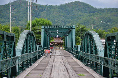 Tricycle thai style on Bridge over Pai River at Pai at Mae Hong Son Thailand photo