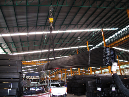 Working with Crane over head in Steel warehouse   Éditoriale