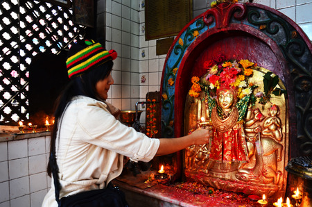 Traveler Thai woman prayer in god house at Thamel Kathmandu Nepal  photo