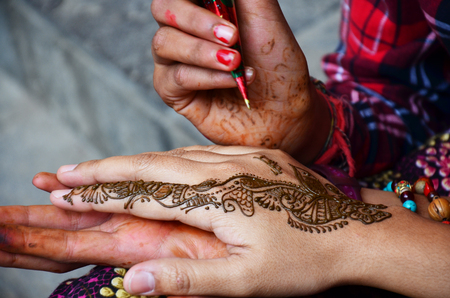 Mehndi or Henna india style at Thamel market street Kathmandu Nepal photo