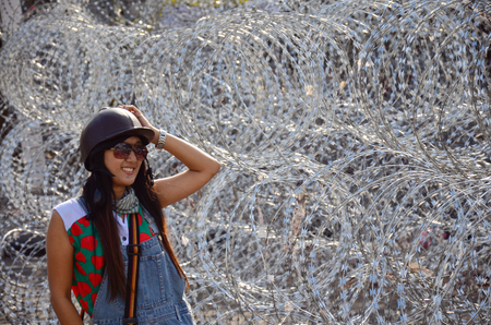 Thai woman portrait with Barbed wire for Defence at Bangkok Thailand photo