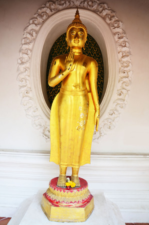 Statue Thai image of Buddha at Phra Pathom Chedi  photo