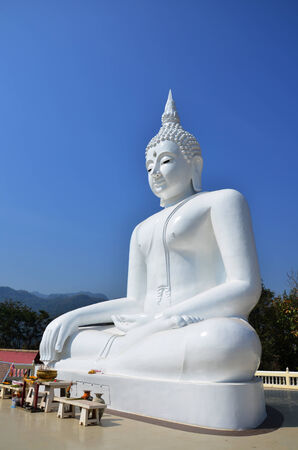 White Buddha at Kanchanaburi Thailand photo