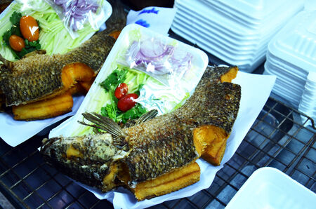 Snake-head fish Deep Fried serve with Herb and Spicy Sauce photo