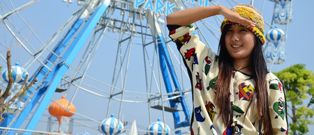 Portrait thai women with Ferris wheel photo
