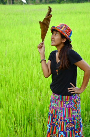 Thai Women portrait at location rice field or paddy in Phatthalung Province Thailand photo
