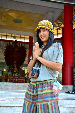 Portrait thai women praying at Wat Pusawan Phetchaburi Thailand photo