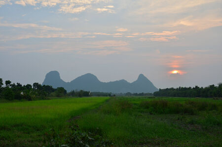Sunset at Mountain name Khao Oktalu in Phatthalung Thailand photo