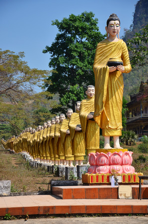 Buddha image statue at Tai Ta Ya Monastery or Sao Roi Ton Temple of Payathonsu in the south of Kayin State, Myanmar photo