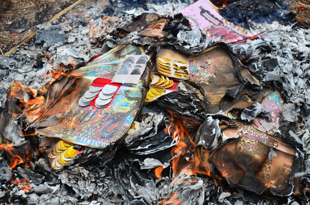 Burn joss paper or hell money Chinese Culture in The Qingming Festival