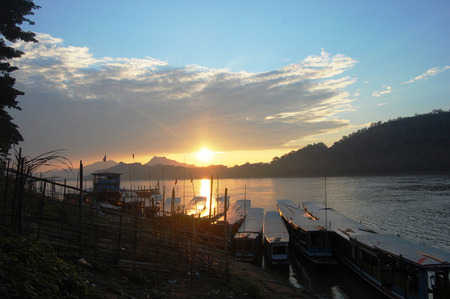 Sunset with Fishing boat on Mekong river in Luang Prabang City at Loas Lao People s Democratic Republic  photo
