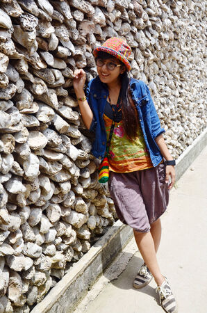 oyster shell: Thai women portrait with Oyster Shell wall in Wat Chedi Hoi, The Oyster Shell Temple located in of Pathum Thani Province, central Thailand