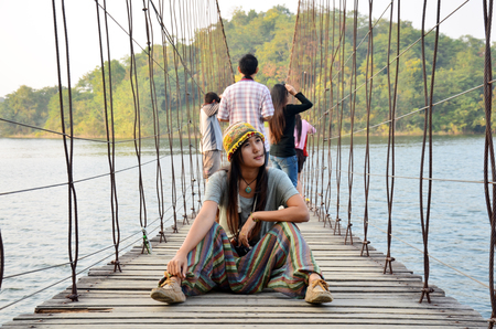 kaeng: Thai Woman portrait on the bridge at location Kaeng Krachan Dam in Kaeng Krachan National Park at Phetchaburi Thailand   Stock Photo